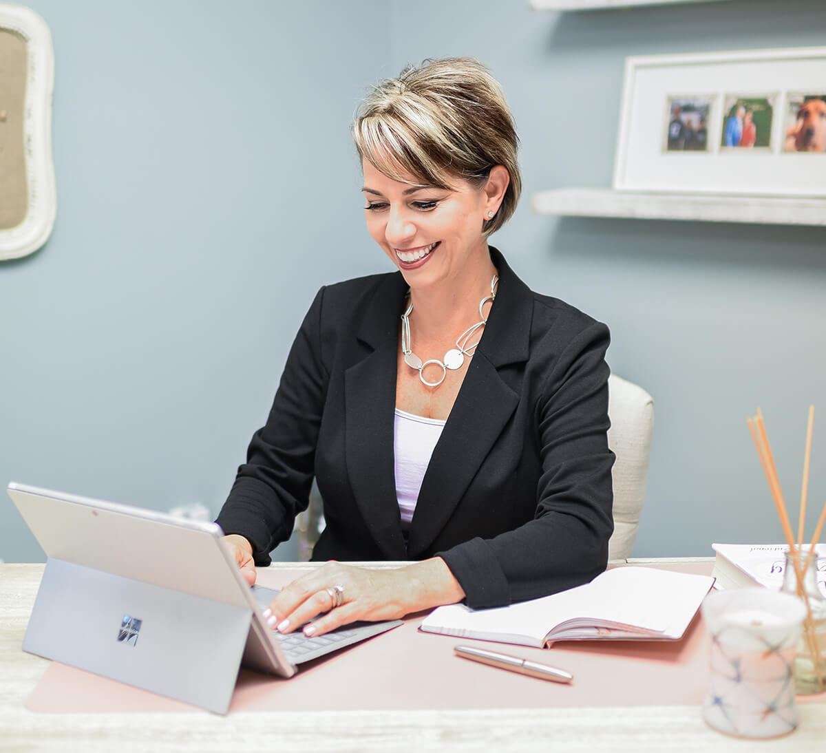 Tricia Manning writing at her desk